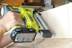 Using a cordless brad nailer to attach the sides of a DIY chicken coop Chicken Coop Building Plans, Chicken Coop Plans Free, Easy Chicken Coop, Portable Chicken Coop, Chicken Coop Designs, Backyard Chicken Coops, Chickens Backyard, Keeping Chickens, Free Plans