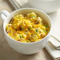 Bacon and Cheddar Egg Mug Scrambler™: Egg Beaters with cheese, bacon bits and green onion microwaved in a mug for a quick breakfast