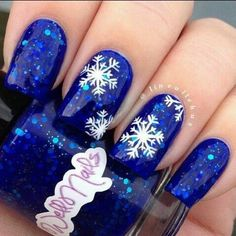 christmas nail art design - blue glitter nails with white snowflakes.