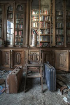 """Manor House Library © Stuart DEADMAN Photography .... Old, Abandoned, Forgotten, Dusty, Library, Suitcases, ... """"He loved a book because it was a book; he loved its odor, its form, its title. What he loved in a manuscript was its old illegible date, the bizarre and strange Gothic characters, the heavy gilding which loaded its drawings. It was its pages covered with dust — dust of which he breathed the sweet and tender perfume with delight."""" ~Gustave Flaubert"""