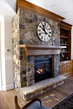 the way the stone juts out around the opening of the fireplace.