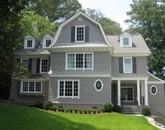 "Gray Shingle Home Paint Color: ""Dorian Gray SW7017 Sherwin Williams""  Trim Paint Color: ""Benjamin Moore Snowfall White  OC 118″.  Shutters Paint Color: ""Sherwin Williams Black Fox 7020""."