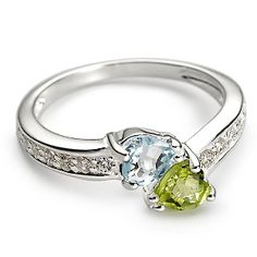 couples ring: select yours and your partners birth stones.... IF ONLY THEY WERE NOT CHRISTMAS COLORS