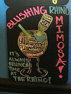 Blushing Rhino Mimosa's are now Available! Fresh Orange Juice, Verdi Champagne, Midori, Grenadine and Watermelon Sugar Kiss on the Rim. It's ways Brunch Time at The Rhino. ;)