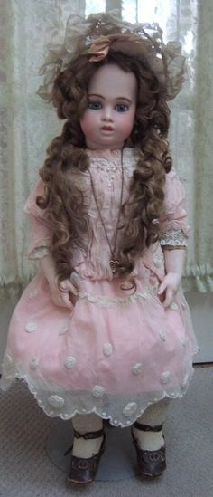 This doll is a prize from my personal collection and was made in the early to mid 1880's. In fact, she is in my logo! This Circle Dot Bru stands 25 tall and has it all! Her bisque head is free from