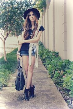 Outfit- especially that fringe vest.