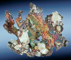 Silver leaves with Bornite and Calcite