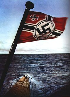 The bow of a German U-boat lurches int the waves featuring the Kriegsmarine War Ensign. A very beautiful photo! Any info on this photo would be much appreciated!