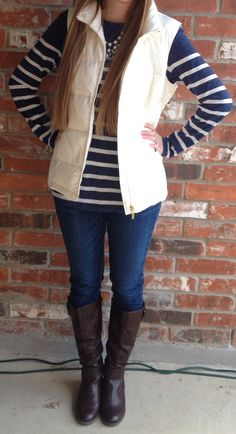 Navy and white striped shirt + bubble necklace + white puffy vest + riding boots