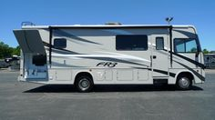 """LOVELY AND VERSATILE MOTORHOME!!!  2017 Forest River FR3 29DS You'll appreciate the homelike touches of this lovely motorhome, like black walnut cabinetry, ultra leather furniture, and awesome LED TVs! Feel free to take the party outside, since this model has an outdoor kitchen and entertainment center! The 29DS is 30'9"""" long and is powered by a gas engine! Give our FR3 expert Gabrielle Selvius a call 616-890-3879 for pricing and more information."""