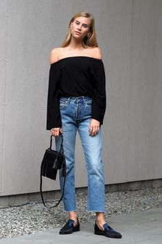 Photos via: The Fashion Eaters It's no secret that off-the-shoulder tops are everywhere for summer. We absolutely approve of how Tine wears her black version with vintage-style jeans, a fringe mini bag...