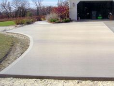 See this image on Best Concrete Concepts, LLC.: new driveway with border