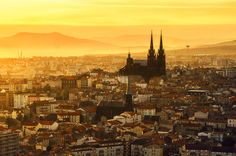 City of Clermont-Ferrand in Auvergne at the sunrise.