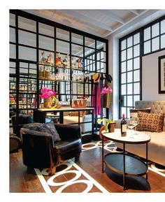 stenciled floor, mirrored wall, and windows- Interiors Mag