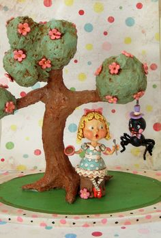 This piece has been in my head for the last year or so, and I finally decided to dig in.The Tree was sculpted from paper mache, and Little Miss Muffet and the Spider were sculpted from paper clay over foam, wood and wire armatures, They are poised upon a salvaged, polka dot painted wooden tray.