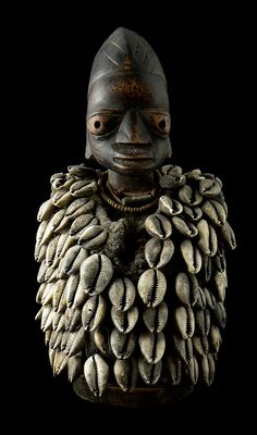 Africa | 'Ibeji' from the Yoruba people of Nigeria | Wood, glass beads, cowrie shells and textile