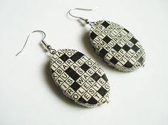crossword puzzle earrings. bet I could figure out how to diy this... via Dawanda