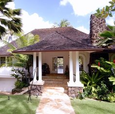 This oversized Gabled Porch with the distinctive Hawaiian style roof lines totally makes this entrance.