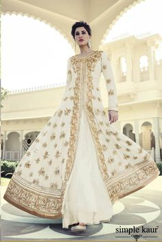 This cream and gold embroidered anarkali is an all time classic and one of my personal favorites too.  Shop on at  http://www.simplekaur.com/Contemporary/Cream-and-Gold-Embroidered-Anarkali-id-2506016.html or  Simple Kaur SCO 481, Himalaya Marg, Sector 35 -C, Chandigarh.