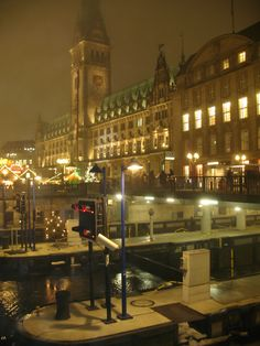 Looking over the canals at the main Christmas market  and the Rathaus, Hamburg.