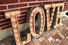 4 Custom Wedding Letters LOVE Marquee Signs Rustic Industrial Marque lighting w/ Metal, Wood and Vintage Light Bulb Letter Sign Wall Light by GoldenSpikeSawdust on Etsy https://www.etsy.com/listing/224264946/4-custom-wedding-letters-love-marquee