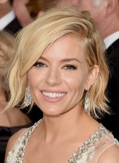 Sienna rocks her new shorter, tousled 'do on the red carpet, keeping her lashes long and her lips nude.