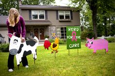 "Leah Iseler, 17, of the Triple B For Cure 4-H Club, places wooden animals in the yard of a Midland Home. The club puts the ""herd"" of animals in yards and then takes donations to move them to another yard. The hope is to collect $2,000 by the end of July."