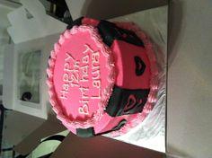 Pink buttercream and black fondant birthday cake