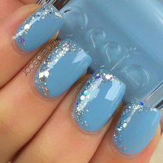 Pale Blue Nail Art Design with Glitter and Beads on Top.