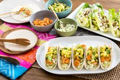 Shrimp & Pineapple Soft Tacos with Creamy Cabbage Slaw & Crunchy Romaine Salad. Visit https://www.blueapron.com/ to receive the ingredients.