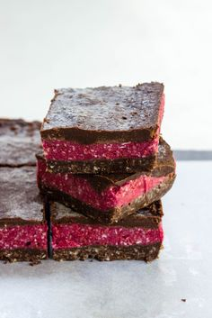 Raw Chocolate Raspberry Slice | Dairy free, these layers of deliciousness are a great alternative to brownies. 30 mins to prep and three hours freezing time