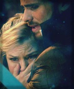 If you look closely Hook is crying. At first i thought it was because of Snow White's death. Now, looking at it carefully, he grabs her and holds her close and sheds a tear thinking that Emma was going to fade away.<--I'm not sure if he's actually crying, but THIS