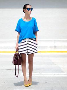 blusa mais estruturada, alto contraste e cores distribuídas = look elegante e descontraído, disfarçando a barriga e alongando as pernas.