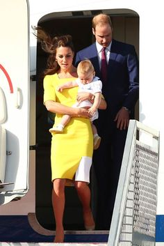 Kate, William and George step off the plane in Sydney Australia. She is wearing a sunny yellow Rocksanda Llincic dress and a pair of her beige LK Bennett heels. April 15, 2014.