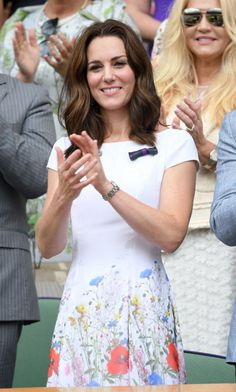 Kate Middleton wore a short-sleeved Catherine Walker dress with floral details for the final day of Wimbledon 2017 on July 16. Photo: Getty Images