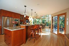 Sunrooms and kitchens on pinterest for Kitchen with sunroom attached