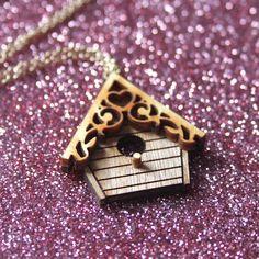 Birdhouse necklace - laser cut wood. £12.00, via Etsy.