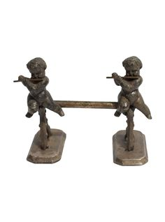 French Putti Metal Children Knife Rest  | Via @The_HighBoy at http://www.thehighboy.com/ #antiques #vintage #decor