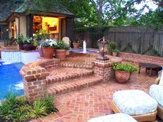 Brick patio with plantings, pot and lantern