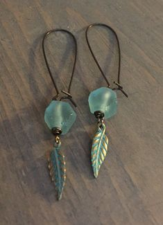 Large oval bronze earrings with aqua African frosted seaglass & feather