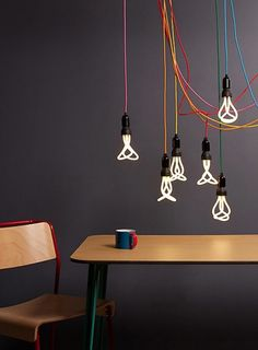 A like this but are the bulbs fluorescent? Hanging clusters with exposed bulbs have to be dimmable ...