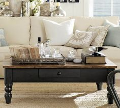 Cool coffee table from pottery barn, would totally match my couch & chairs, since they are brown and black....wish it wasn't $699
