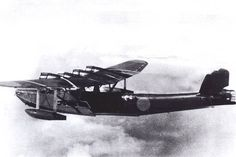 Kawanishi H6K in flight. Note bomb rack with bombs on wing-brace.