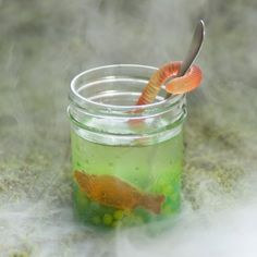 Swamp juice. Tapioca pearls gummy fish, lemonade, seltzer water. Finished with a gummy worm wrapped spoon