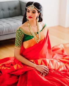 South Indian bride. Gold Indian bridal jewelry.Temple jewelry. Jhumkis. Red silk kanchipuram sari with contrast green blouse.Braid with fresh jasmine flowers. Tamil bride. Telugu bride. Kannada bride. Hindu bride. Malayalee bride.Kerala bride.South Indian wedding.