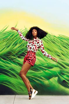 Solange Knowles | Harper's BAZAAR Magazine. wedge sandals, printed shorts and top, grass background