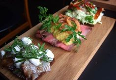 Denmark's finest gastronomical invention is the unpronounceable and mouthwatering smørrebrød (open sandwich). A classic smørrebrød consists of a piece of rye bread hidden under different kinds of meat or fish and topped with a small mountain of pickles.