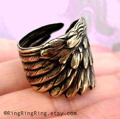 Angel feather ring, Antiqued gold brass ring jewelry, bird wing ring, for men and women. $29.00, via Etsy.