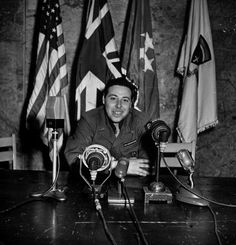 LIFE photographer/war correspondent Ralph Morse posing for his own surrenderday memento in the same chair from which General Eisenhower announced...