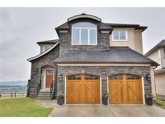This beautiful Albi custom-built estate home is ideally located at the end of a cul-de-sac, backs onto the ravine & has amazing city, COP & mountain views. The main floor features hardwood floors and